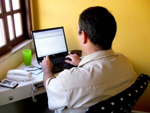 Man writing an email