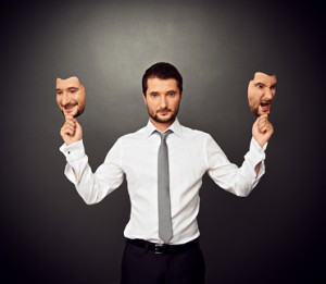 man holding two masks with different moods