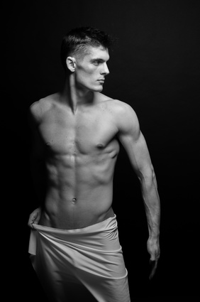 Naked aroused man wearing towel